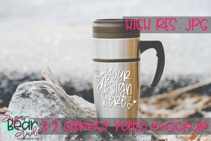 FREE – Travel Mug on a Rock Mockup