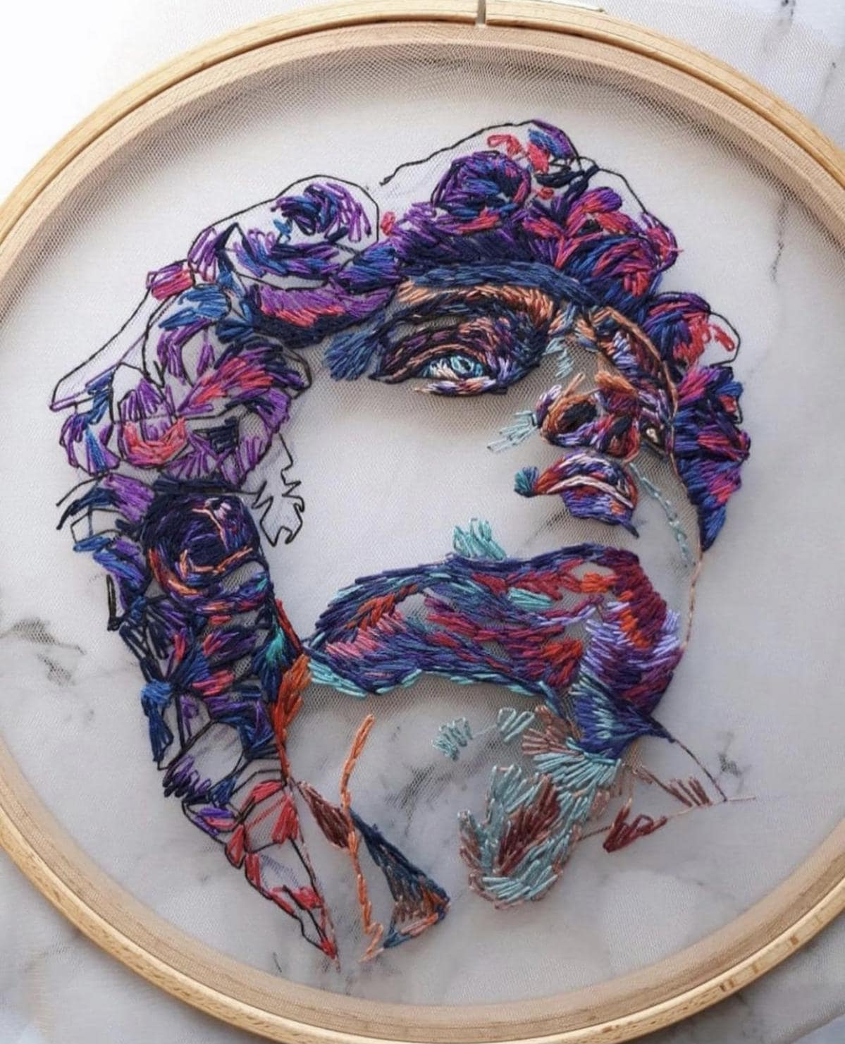 Face embroidery by Kate Marchenko
