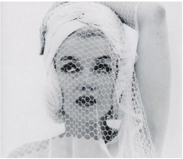 Marilyn looking up in the wedding veil